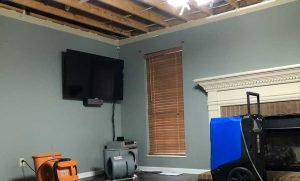 a ceiling damaged by water from a leaky pipe